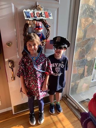 a girl and her brother dressed as a doctor and a policeman!