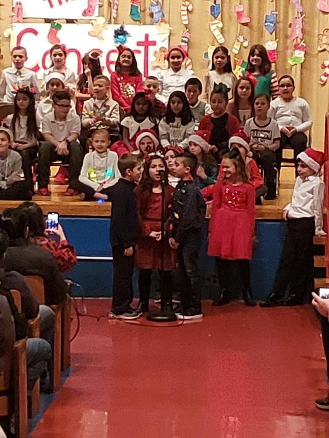 small group og 3rd graders performing