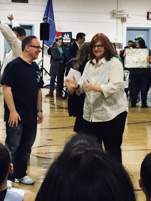 Mrs.Fishman and Mr.Giordano applauding the children