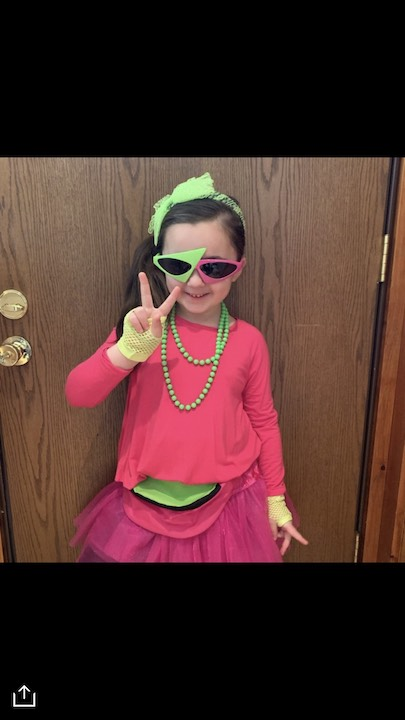 this girl is dressed in hot pink and touches of green with shades to match