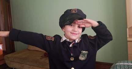 a young boy dressed as a policeman