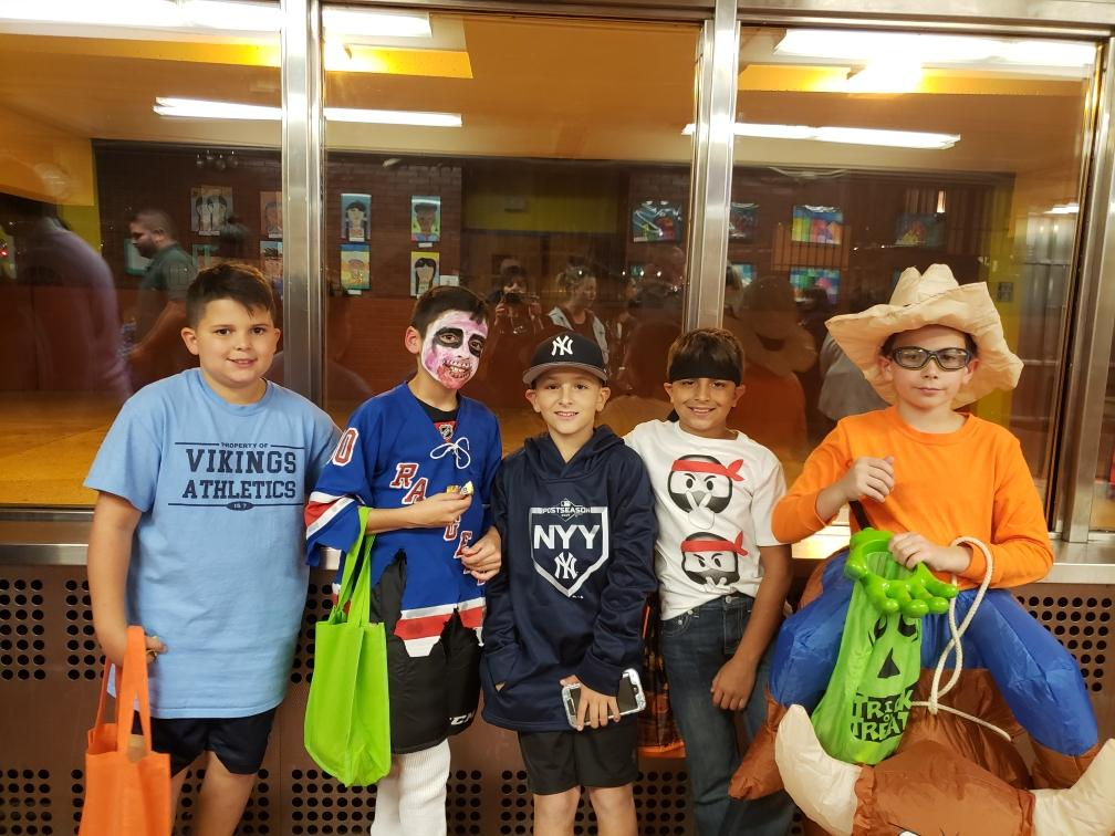 Several boys in costumes