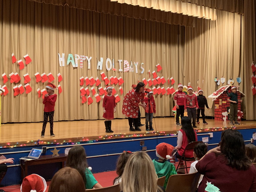 Mrs.Amatrudo and her class on the stage