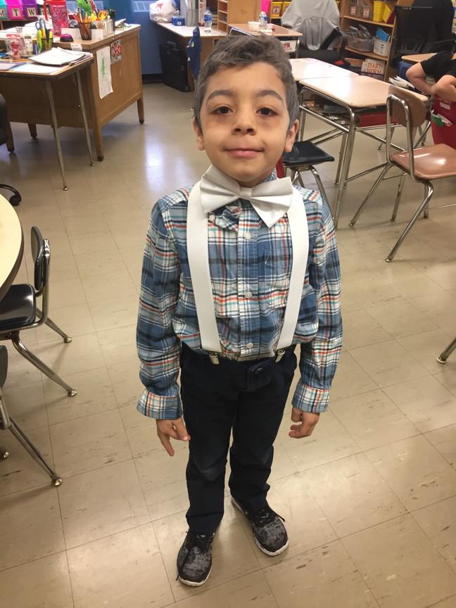 a boy dressed as an old man