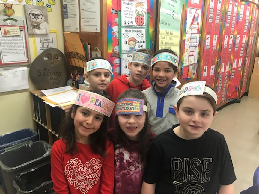 A group of children wearing their I Love Reading headbands that they colored