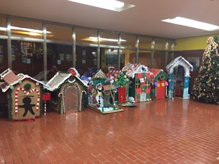 our gingerbread houses displayed in the lobby