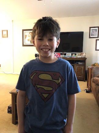 a boy wearing a Superman tee shirt
