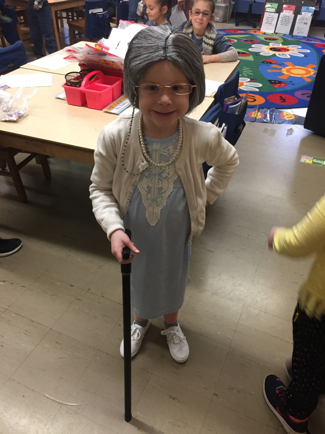 a girl with a cane and a head of grey hair