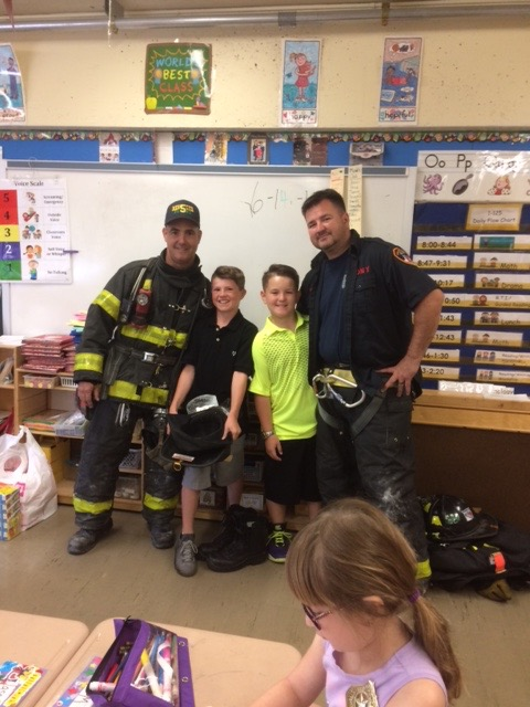 Two firemen with their children
