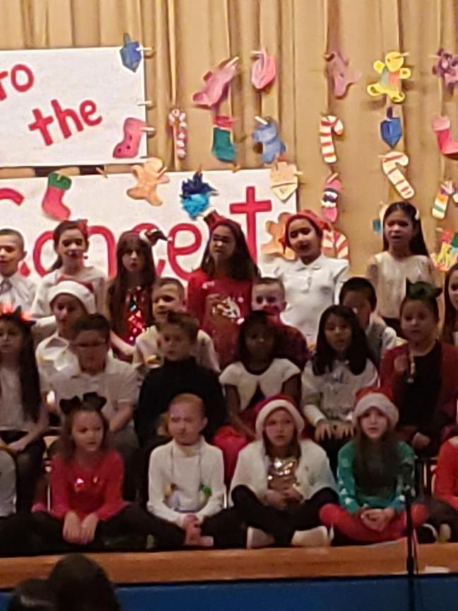 group of 3rd graders on a different part of the stage