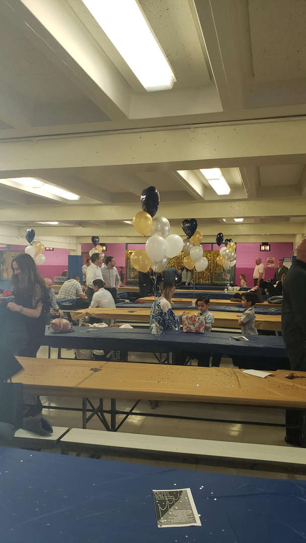 The lunchroom was decorated with balloons in gold, white and black