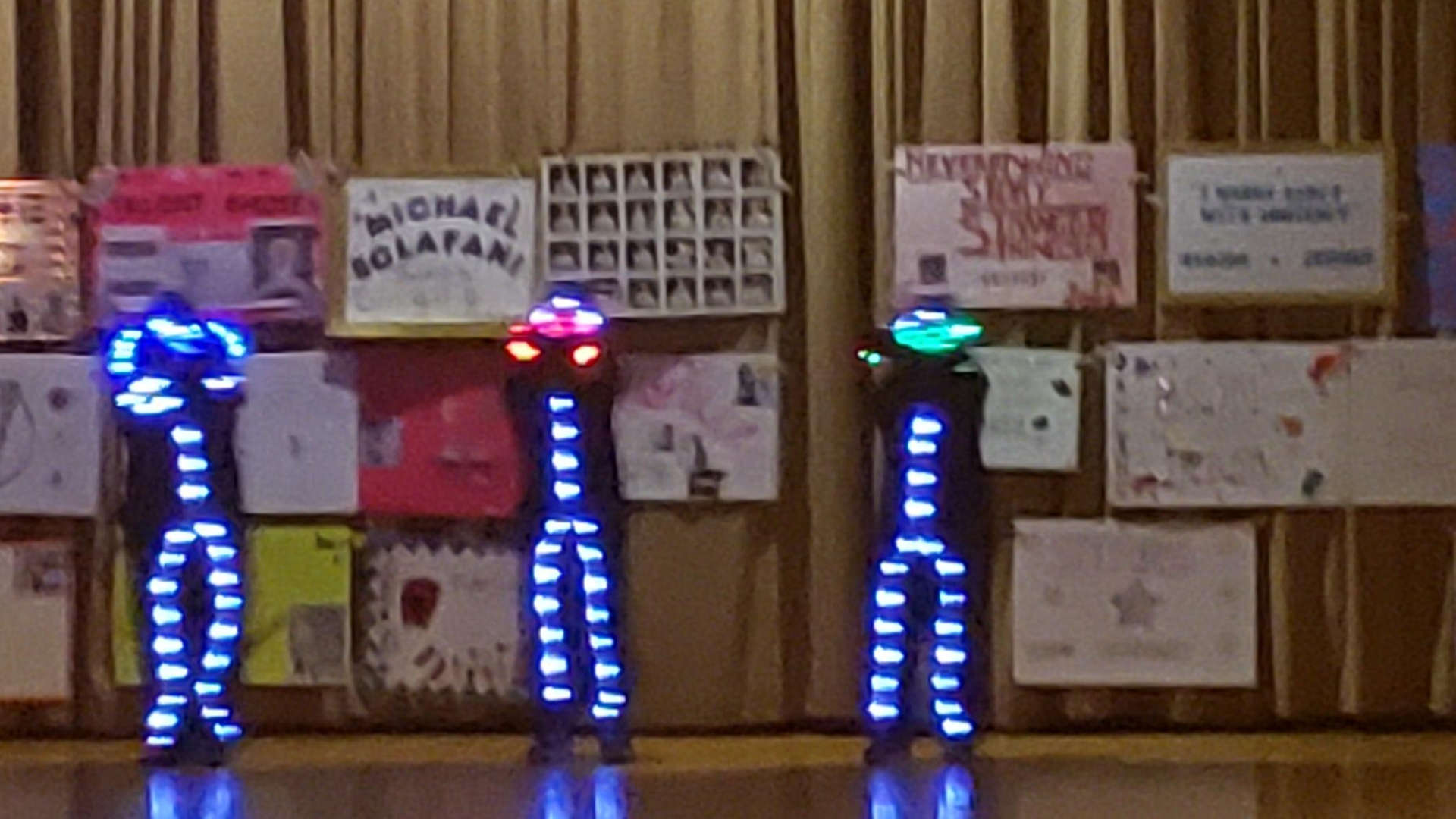 a. trio of dancers dressed in LCD lights as costumes