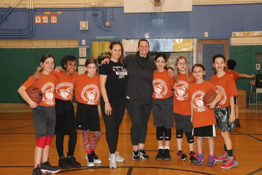 a team shot with their coaches