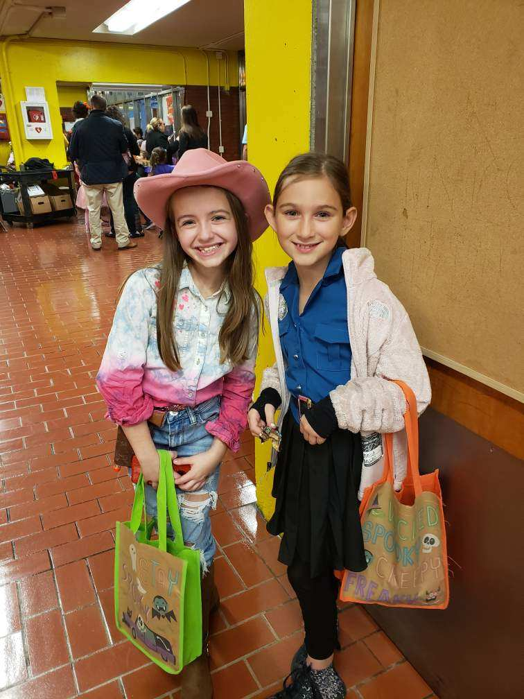 Two girls in costume posing for the camera