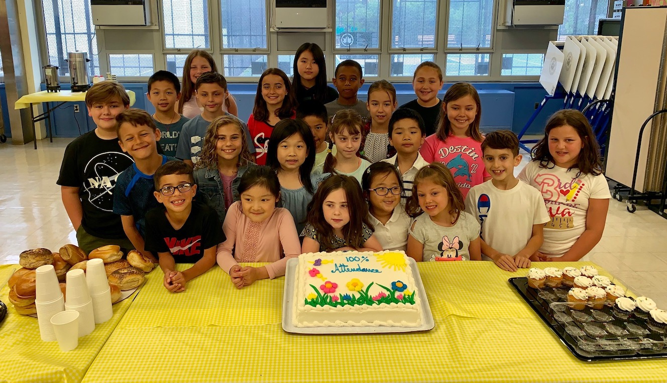 a celebration cake for students with 100% attendance this year!