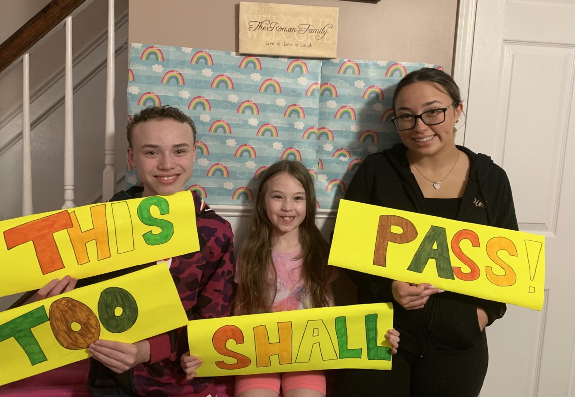 "3 children holding signs that say ""This too shall pass"""