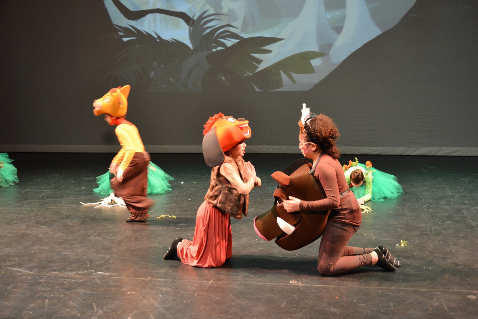 The children dressed as animals dancing