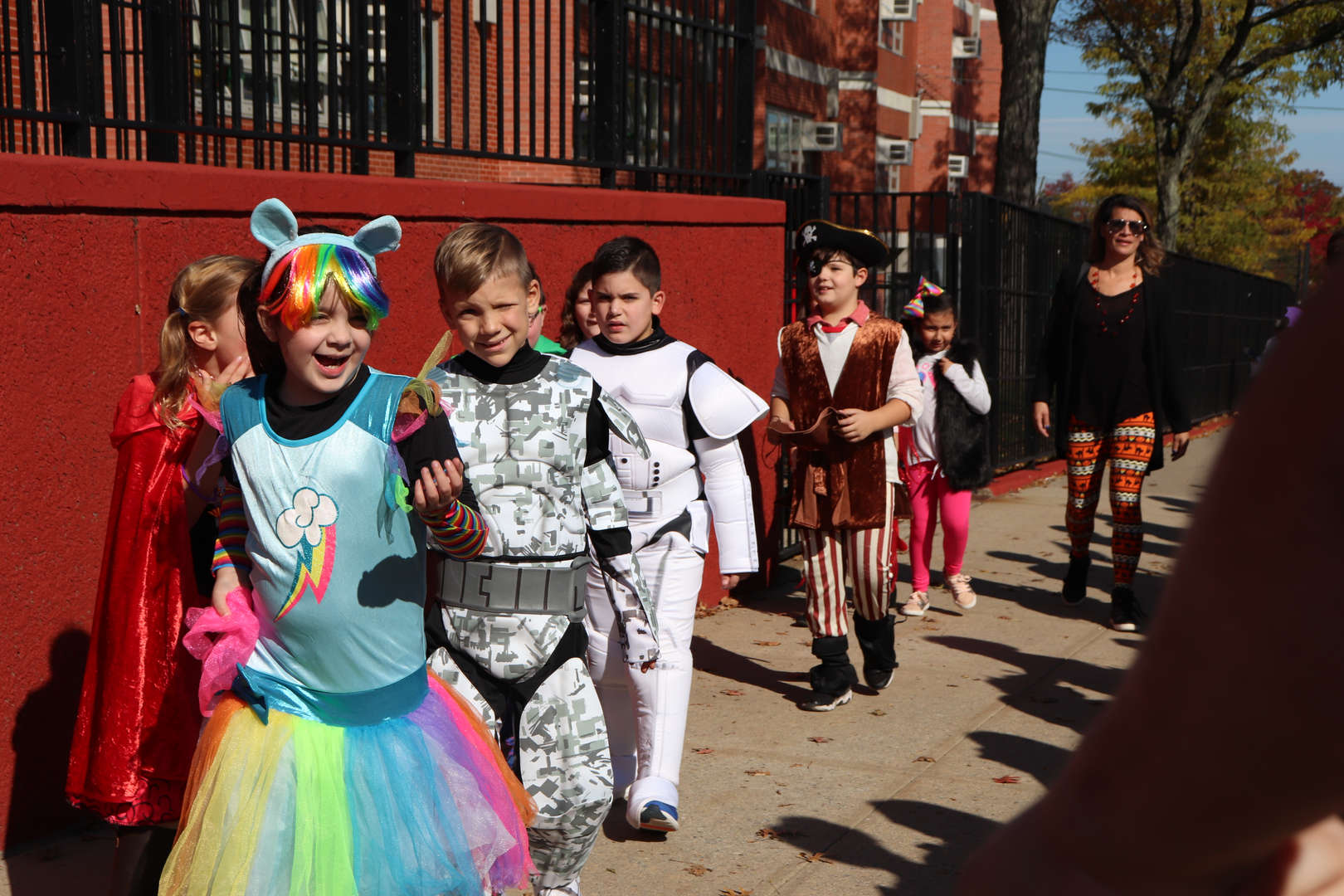 students in costumes walking outside