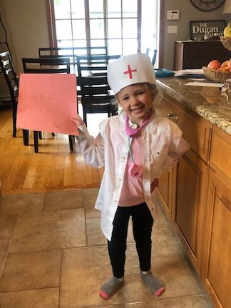 this little lady is dressed as a nurse