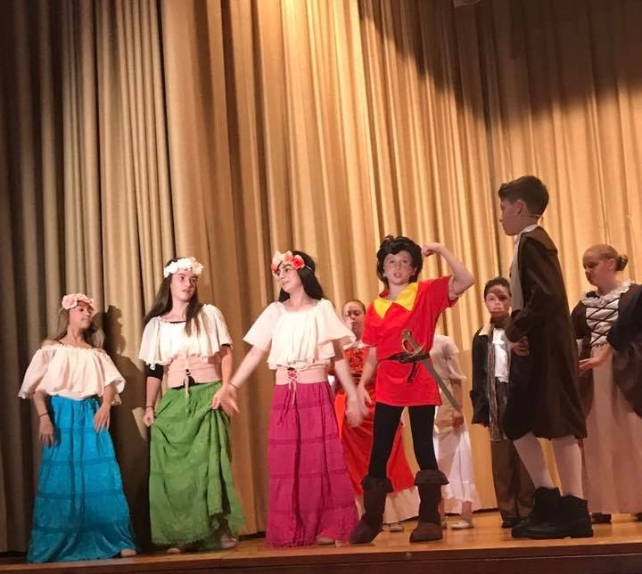 The townspeople singing in the village