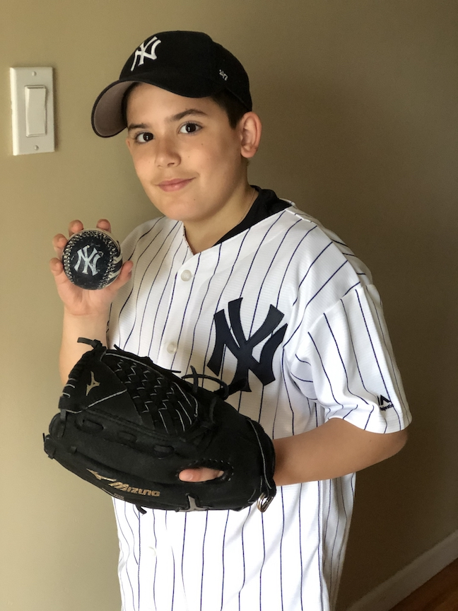 This boy is ready to join the Yankees!