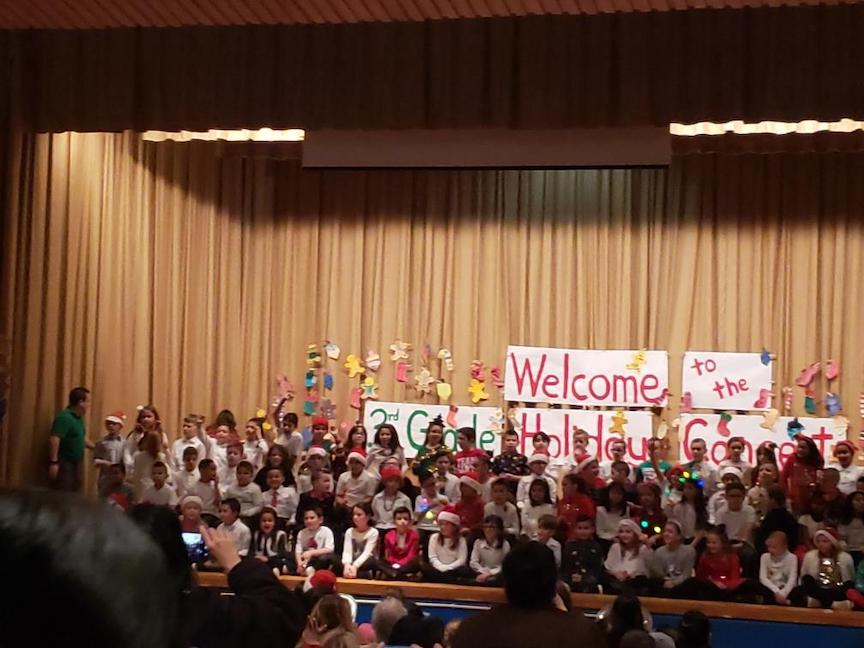 the stage is filled with the 3rd graders