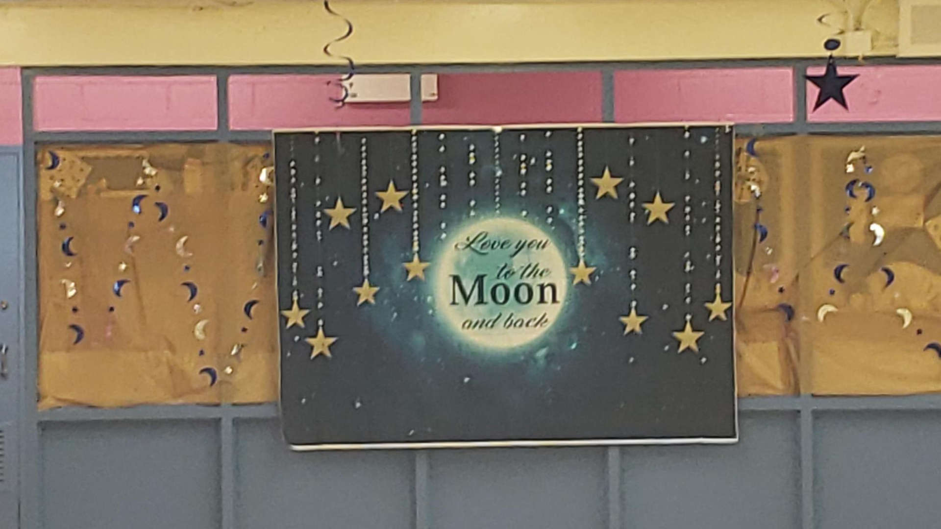 "A banner say, ""Love you to the moon and back"""