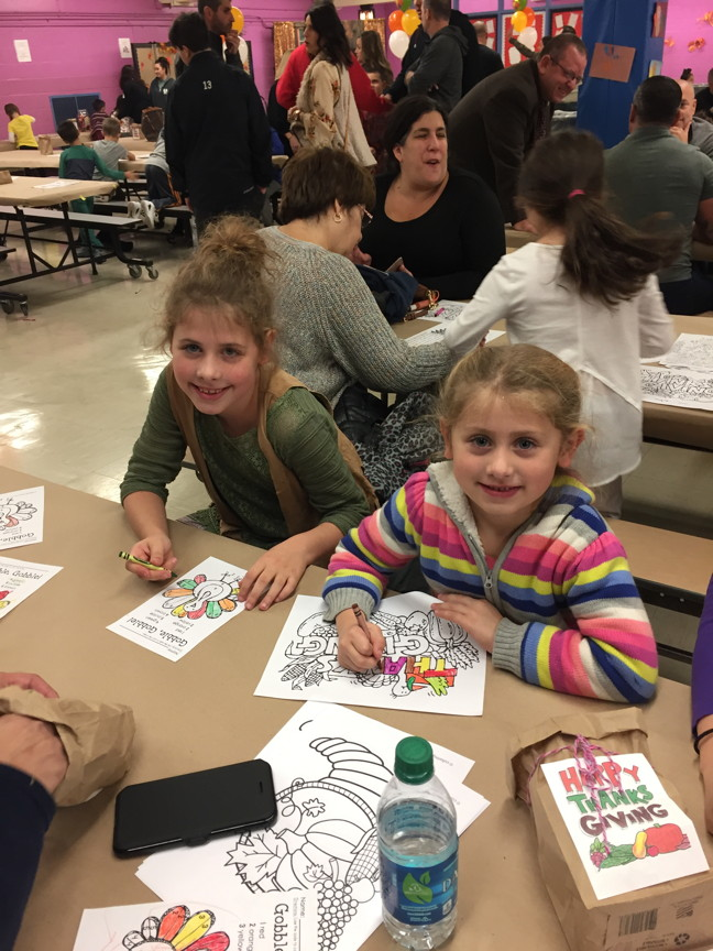 two sisters coloring together