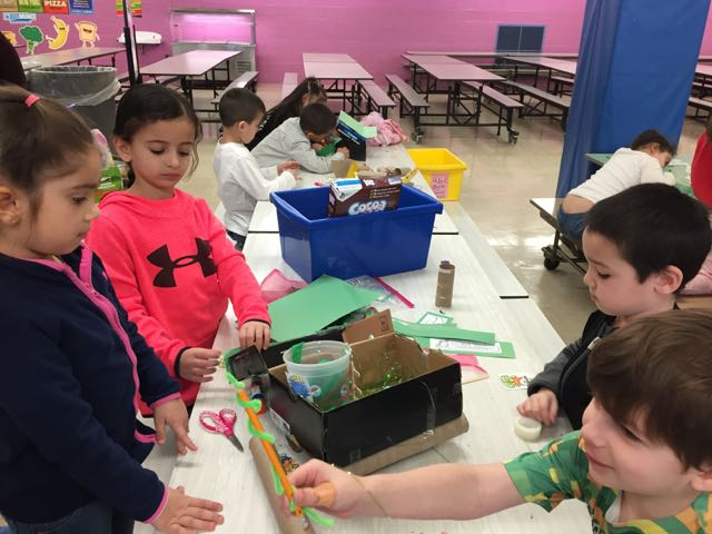 a group of four children working on their project