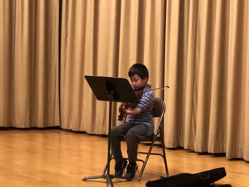 a boy playing a violin