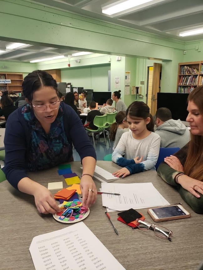 Mrs. Anastasiou working with a mom and her daughter