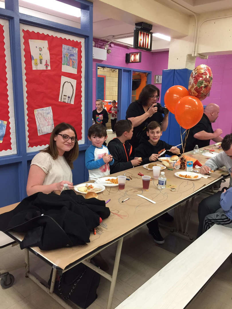 More families eating at a table