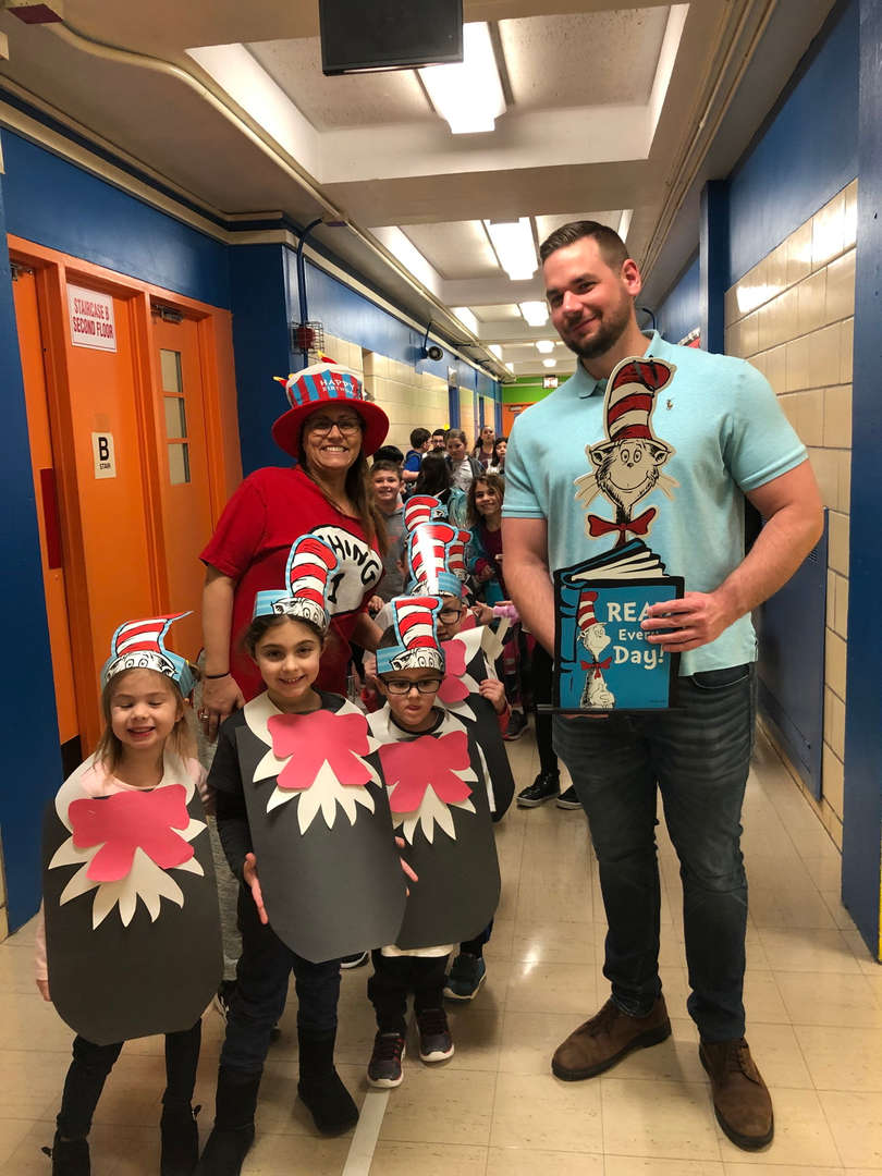 Mrs. Berman and some students with a dad