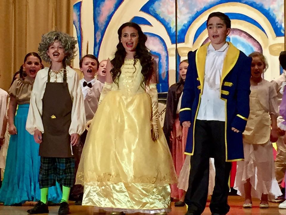 Belle and the Prince taking a bow