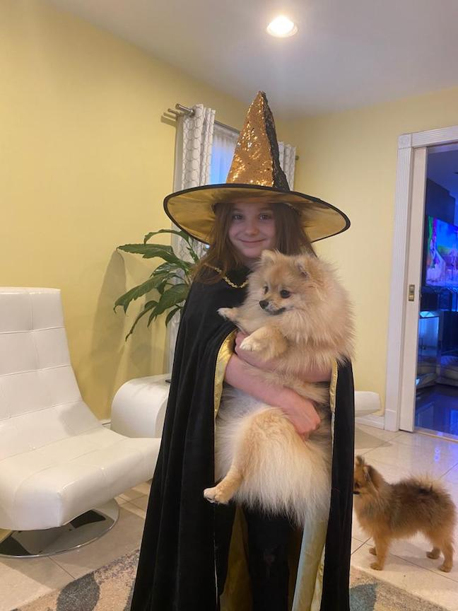 Here is a witch with her dog