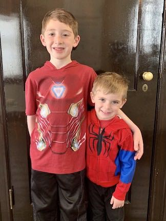 a boy with his younger brother wearing their hero tee shirts