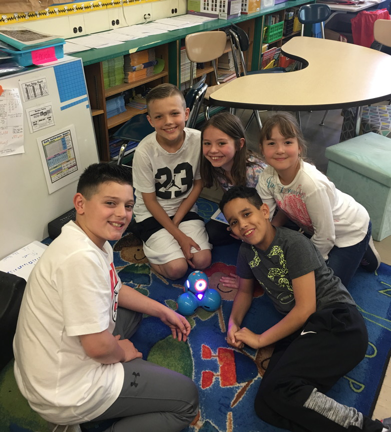 These fourth graders are having fun with the robot