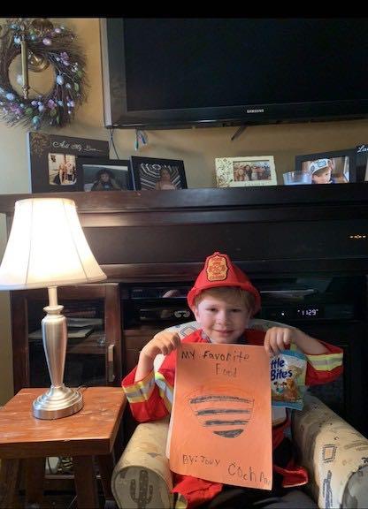 a boy dressed as a fireman