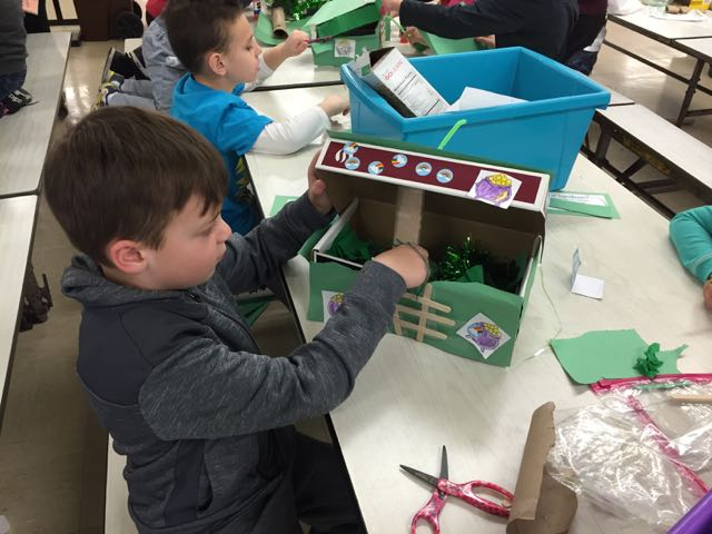 a boy working on his St. Patrick's project