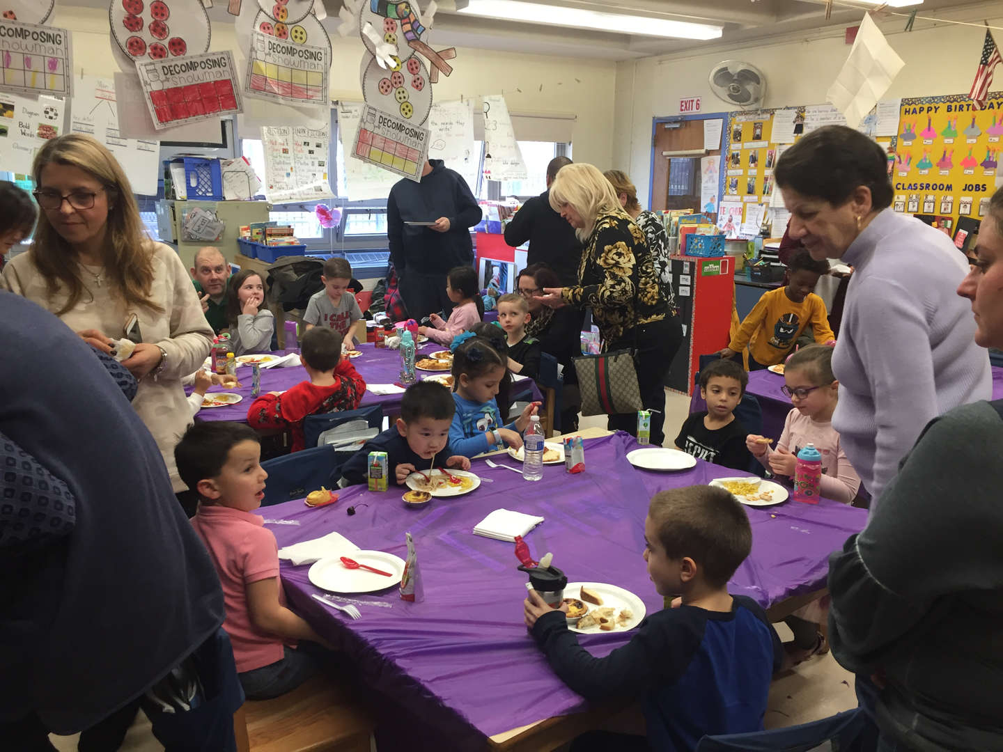 parents and children sampling the food