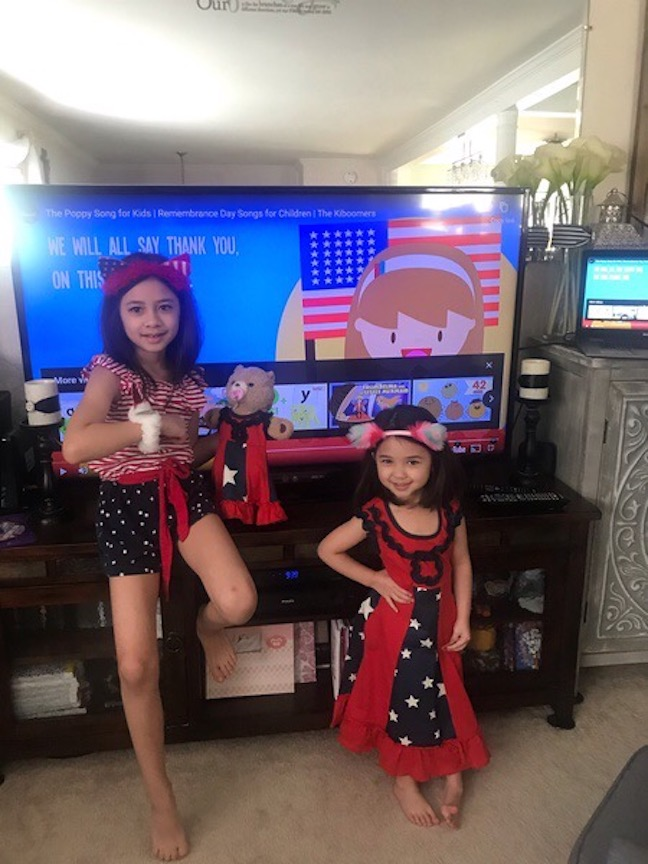 Here are 2 girls wearing their best patriotic colors