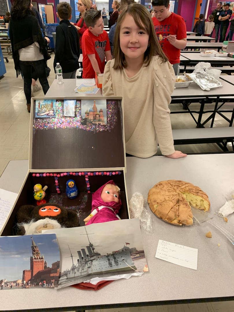 a student with her cultural display and food