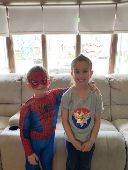a girl and her brother dressed as superheroes