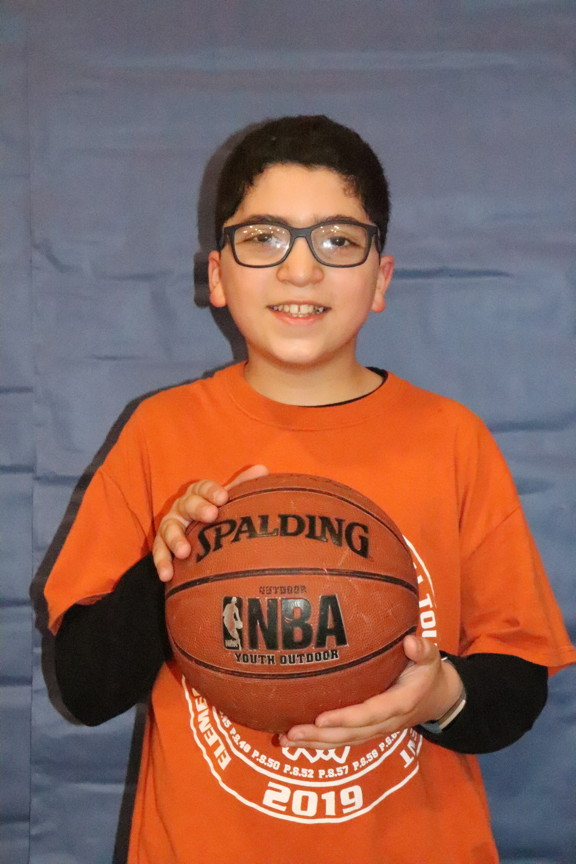 boy with glasses holding the ball