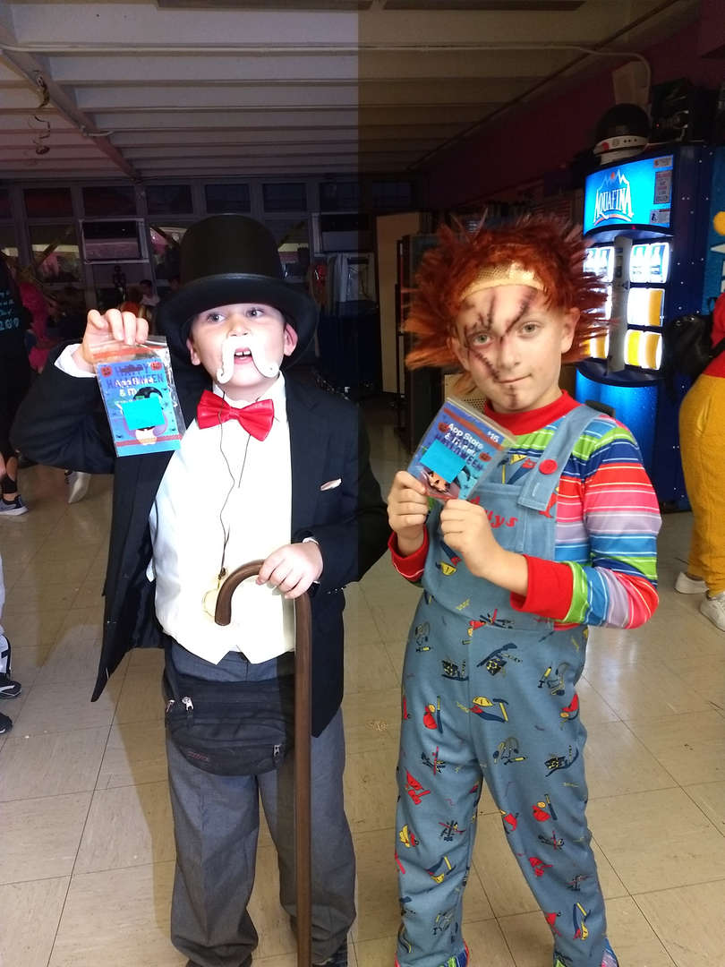 2 boy students in costume