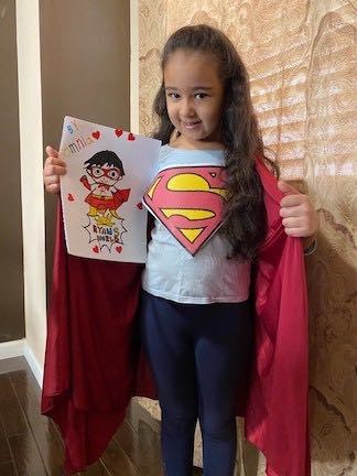a girl in a Supergirl shirt