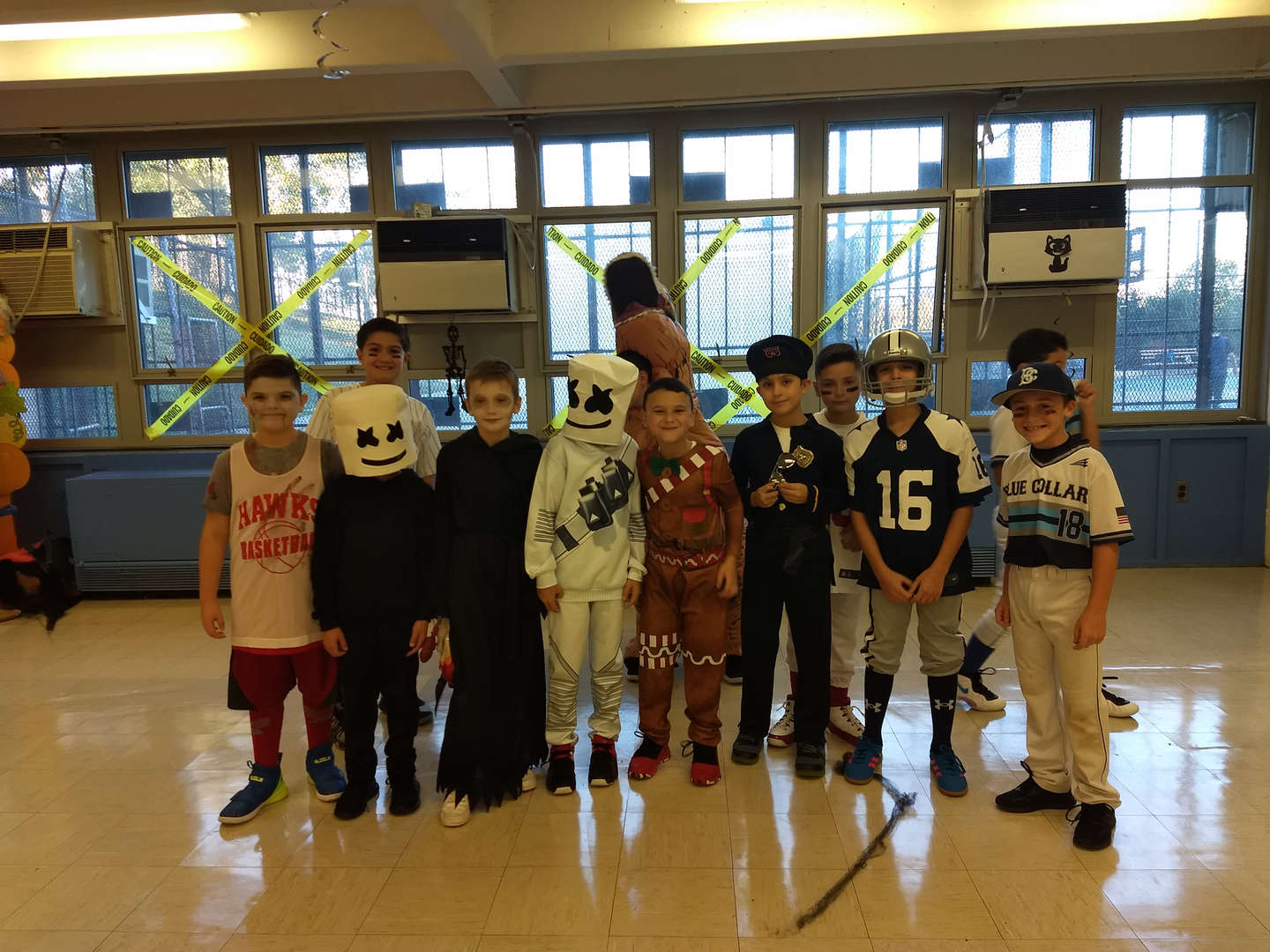 a large group of costumed children