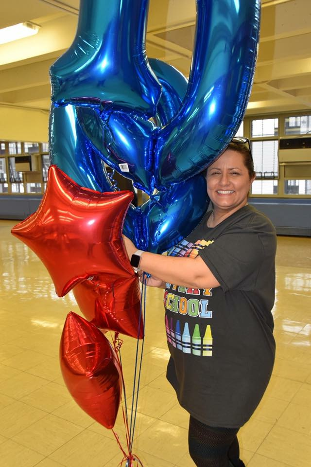 Mrs.Berman with a bunch of balloons