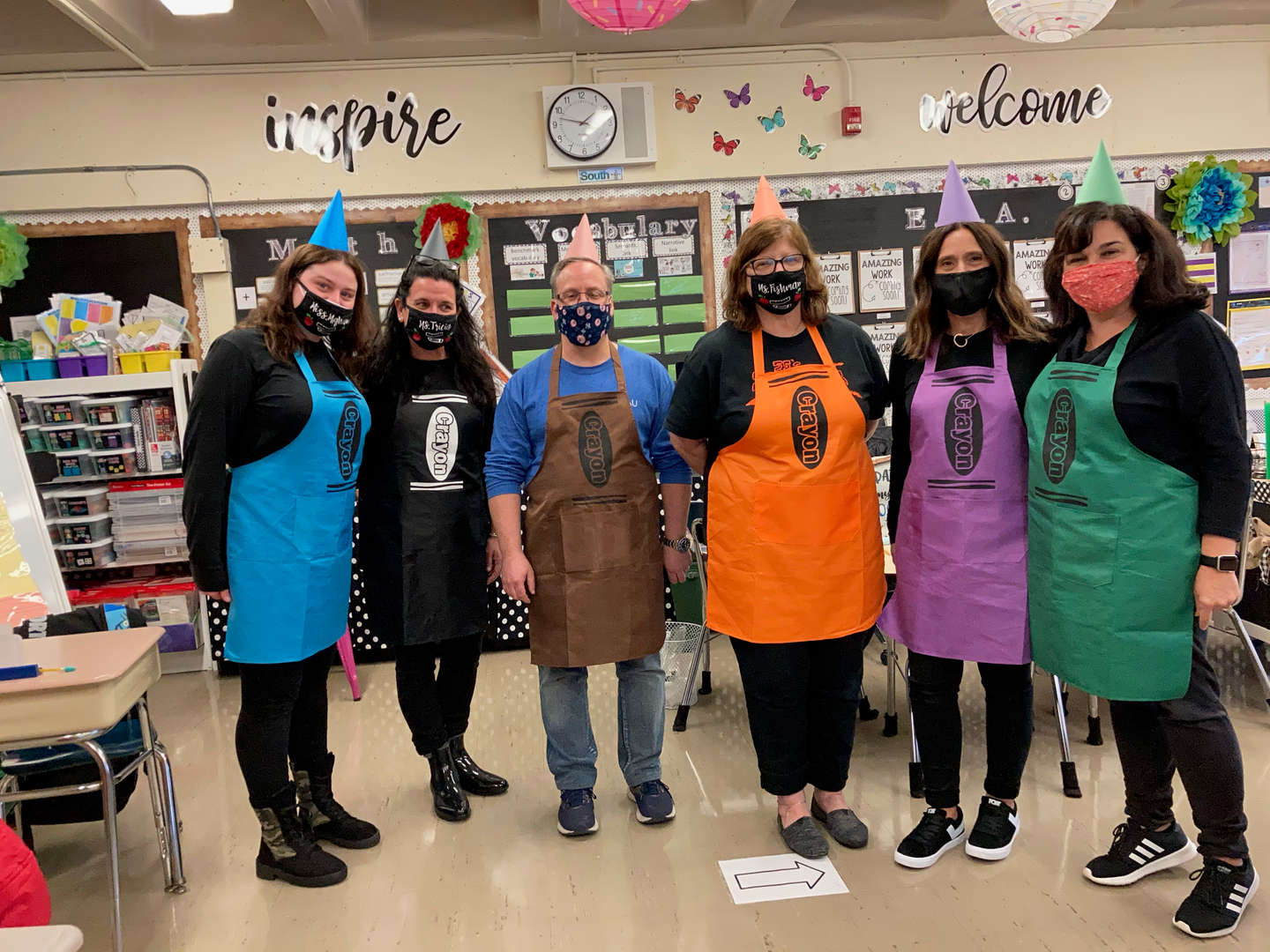 Staff is posing in their crayon costumes