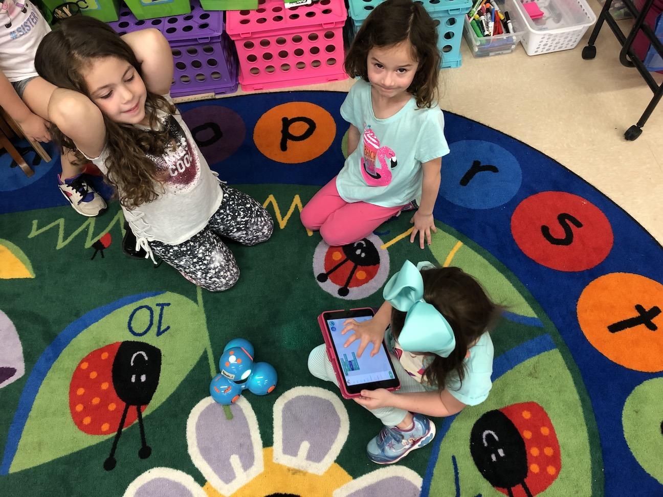 three girls programming the robot